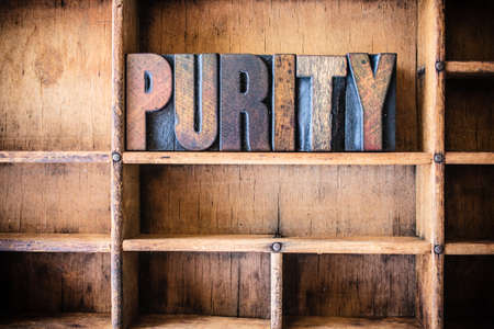 pureness: The word PURITY written in vintage wooden letterpress type in a wooden type drawer.