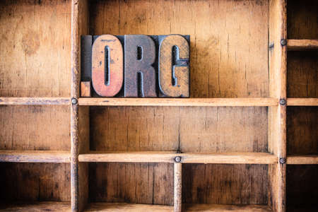 dot com: The word DOT ORG written in vintage wooden letterpress type in a wooden type drawer. Stock Photo