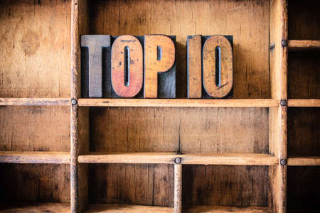 top 10: The word TOP 10 written in vintage wooden letterpress type in a wooden type drawer. Stock Photo
