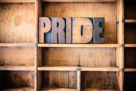 self worth: The word PRIDE written in vintage wooden letterpress type in a wooden type drawer.