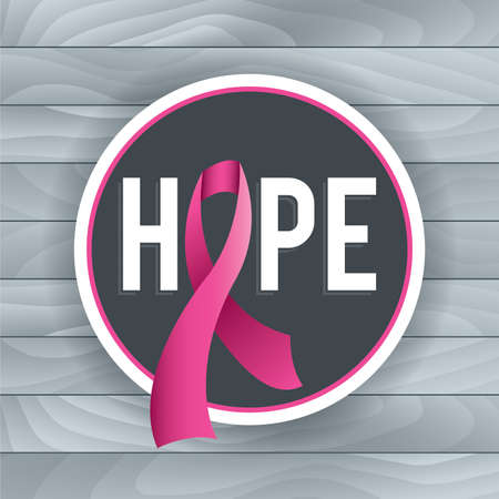An illustration of a pink Breast Cancer Awareness ribbon and badge with the theme of HOPE. Light grey background of wood boards. Vector EPS 10 available. EPS file contains gradient mesh and transparencies.