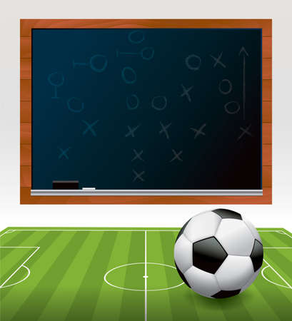 A soccer ball football on a green soccer field with a play drawn on a black chalkboard.