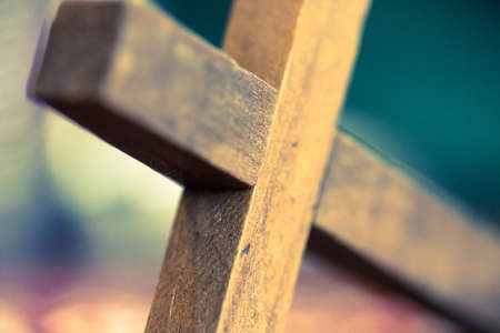 A macro closeup of a wooden Christian cross laying at an angle. Stock Photo