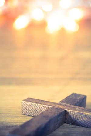 A wooden Christian cross with a soft bokeh lights background. Imagens - 41854837