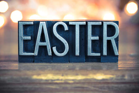 holy thursday: The word EASTER written in vintage metal letterpress type on a soft backlit background. Stock Photo