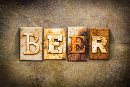 old aged: The word BEER written in rusty metal letterpress type on an old aged leather background.