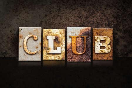 strip club: The word CLUB written in rusty metal letterpress type on a dark textured grunge background. Stock Photo
