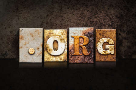 suffix: The word DOT ORG written in rusty metal letterpress type on a dark textured grunge background. Stock Photo
