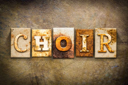 chorale: The word CHOIR written in rusty metal letterpress type on an old aged leather background. Stock Photo