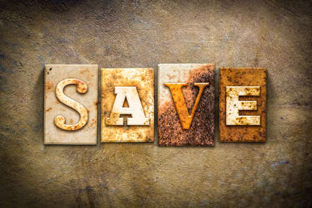 thrifty: The word SAVE written in rusty metal letterpress type on an old aged leather background.