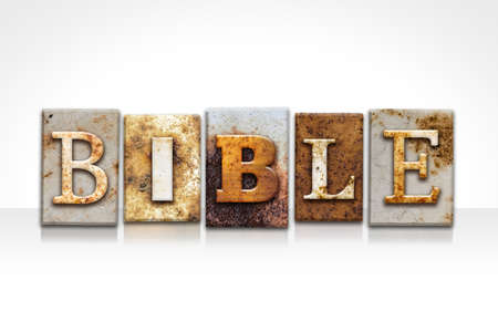 parable: The word BIBLE written in rusty metal letterpress type isolated on a white background. Stock Photo