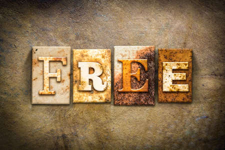 liberate: The word FREE written in rusty metal letterpress type on an old aged leather background. Stock Photo