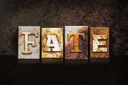 fate: The word FATE written in rusty metal letterpress type on a dark textured grunge background.