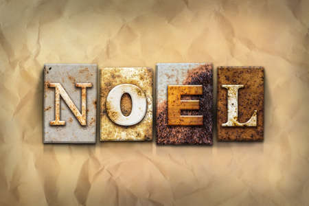 hymn: The word NOEL written in rusty metal letterpress type on a crumbled aged paper background. Stock Photo