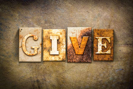 endow: The word GIVE written in rusty metal letterpress type on an old aged leather background. Stock Photo