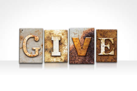 consign: The word GIVE written in rusty metal letterpress type isolated on a white background.