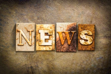 word: The word NEWS written in rusty metal letterpress type on an old aged leather background. Stock Photo