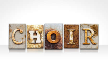 chorale: The word CHOIR written in rusty metal letterpress type isolated on a white background.