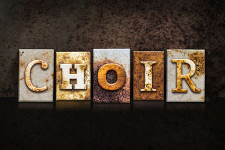 choir: The word CHOIR written in rusty metal letterpress type on a dark textured grunge background.