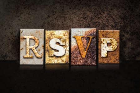 rsvp: The word RSVP written in rusty metal letterpress type on a dark textured grunge background. Stock Photo