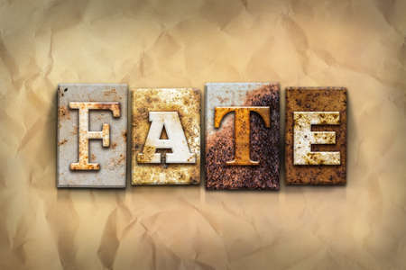 crumbled: The word FATE written in rusty metal letterpress type on a crumbled aged paper background.