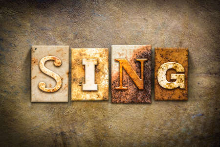 chorale: The word SING written in rusty metal letterpress type on an old aged leather background. Stock Photo