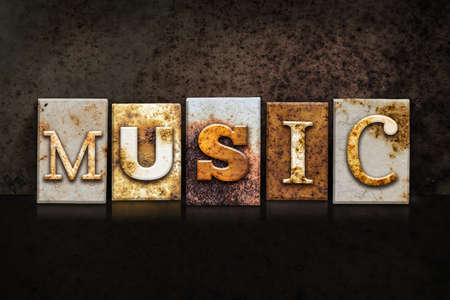 chorale: The word MUSIC written in rusty metal letterpress type on a dark textured grunge background.