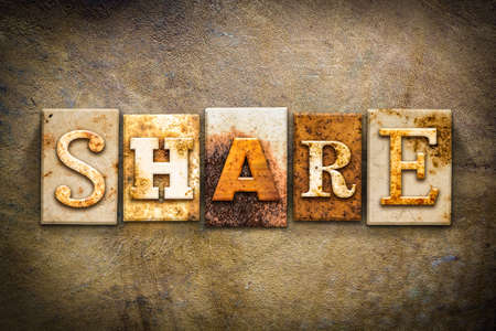 shared sharing: The word SHARE written in rusty metal letterpress type on an old aged leather background. Stock Photo