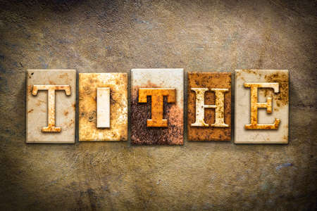 The word TITHE written in rusty metal letterpress type on an old aged leather background.