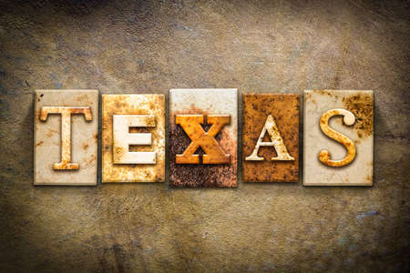 old aged: The word TEXAS written in rusty metal letterpress type on an old aged leather background. Archivio Fotografico