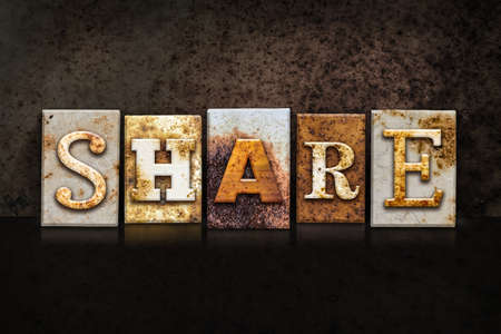 shared sharing: The word SHARE written in rusty metal letterpress type on a dark textured grunge background. Stock Photo