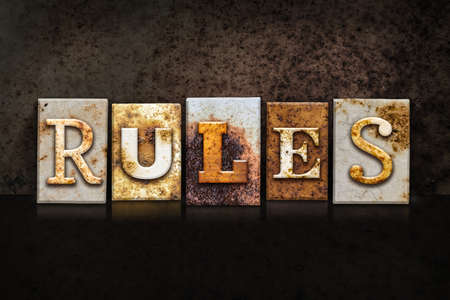precedent: The word RULES written in rusty metal letterpress type on a dark textured grunge background.