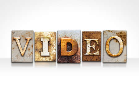 The word VIDEO written in rusty metal letterpress type isolated on a white background.