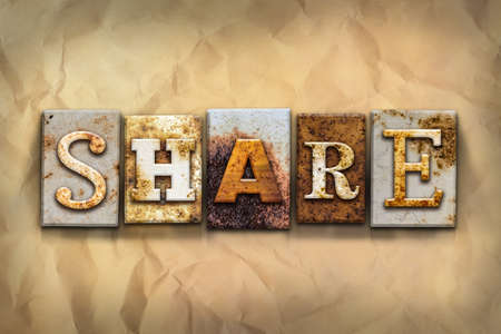 shared sharing: The word SHARE written in rusty metal letterpress type on a crumbled aged paper background. Stock Photo