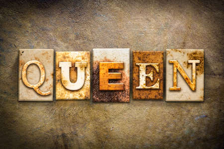 priestess: The word QUEEN written in rusty metal letterpress type on an old aged leather background.