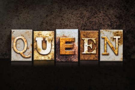 priestess: The word QUEEN written in rusty metal letterpress type on a dark textured grunge background.