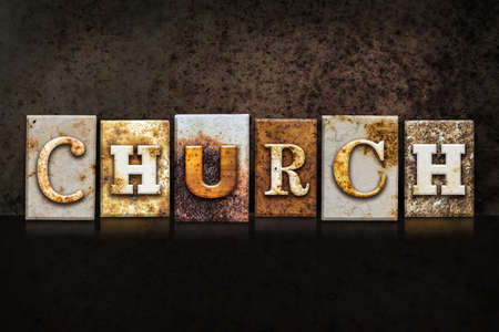 The word CHURCH written in rusty metal letterpress type on a dark textured grunge background.