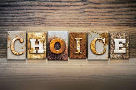 letterpress letters: The word CHOICE written in rusty metal letterpress type sitting on a wooden ledge background. Stock Photo