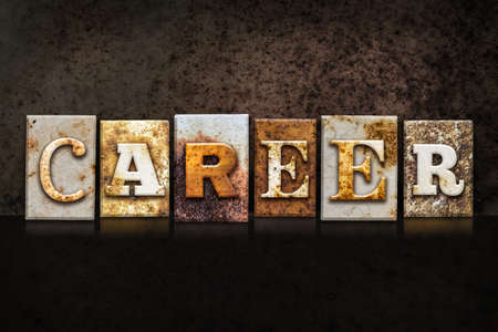 The word CAREER written in rusty metal letterpress type on a dark textured grunge background.