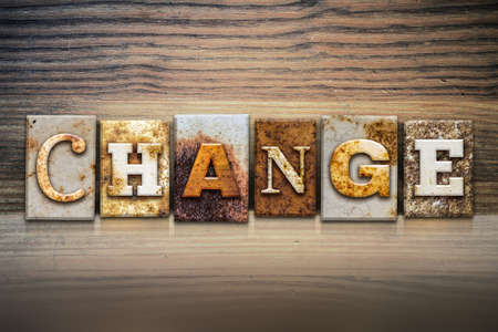 amendment: The word CHANGE written in rusty metal letterpress type sitting on a wooden ledge background.