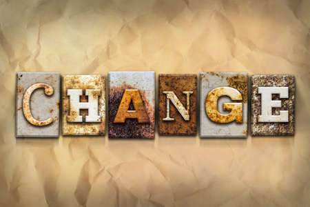 amend: The word CHANGE written in rusty metal letterpress type on a crumbled aged paper background. Stock Photo