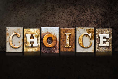 The word CHOICE written in rusty metal letterpress type on a dark textured grunge background.