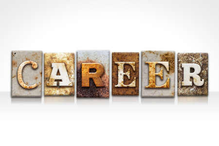 The word CAREER written in rusty metal letterpress type isolated on a white background. Imagens