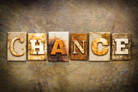 The word CHANCE written in rusty metal letterpress type on an old aged leather background.