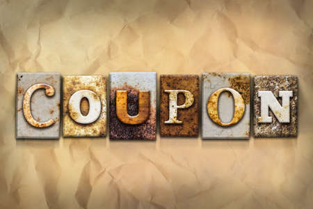 grocery store checkout: The word COUPON written in rusty metal letterpress type on a crumbled aged paper background. Stock Photo