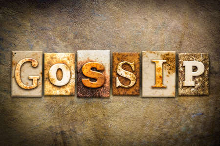 Chatter: The word GOSSIP written in rusty metal letterpress type on an old aged leather background.
