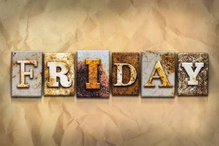 crumbled: The word FRIDAY written in rusty metal letterpress type on a crumbled aged paper background. Stock Photo