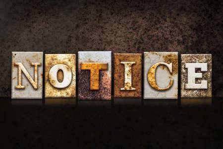 critique: The word NOTICE written in rusty metal letterpress type on a dark textured grunge background.