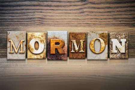 mormon temple: The word MORMON written in rusty metal letterpress type sitting on a wooden ledge background.