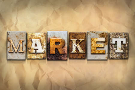 crumbled: The word MARKET written in rusty metal letterpress type on a crumbled aged paper background. Stock Photo